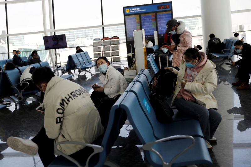 FILE PHOTO: Travellers at Wuhan Tianhe International Airport