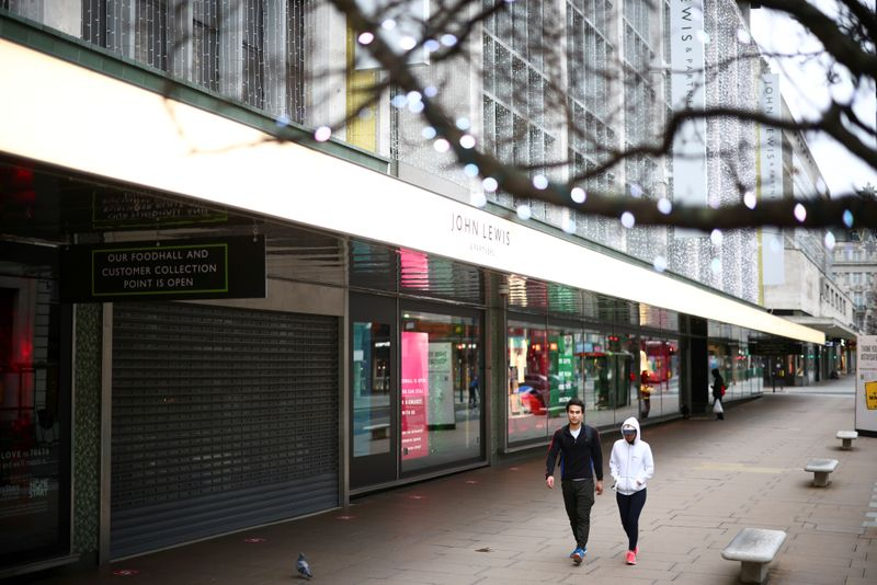 FILE PHOTO: People walk along Oxford Street as shops remain closed under Tier 4 restrictions, amid the coronavirus disease (COVID-19) outbreak, in London