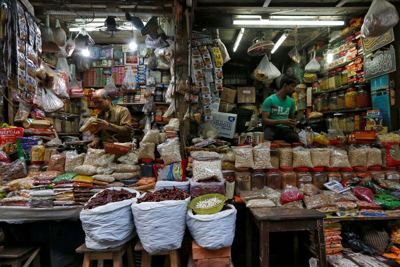 Vendors wait for customers at their respective shops at a retail market in Kolkata