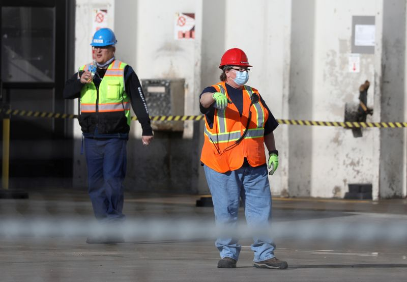 FILE PHOTO: Employees wear face masks at the JBS USA meat packing plant in Greeley