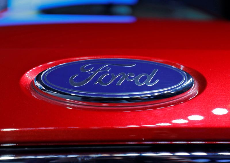The logo is seen on the bonnet of a new Ford Aspire car during its launch in New Delhi