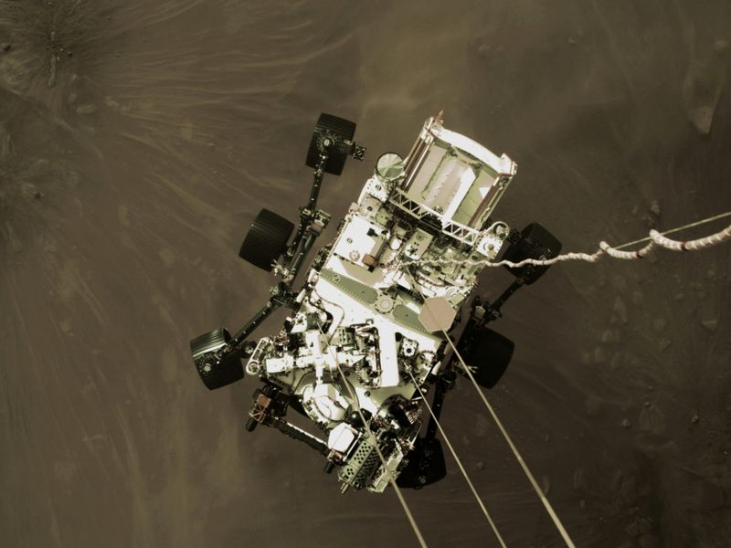 NASA's Perseverance rover descends to touch down on Mars in a still image from a video camera aboard the descent stage