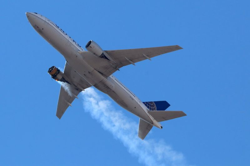 FILE PHOTO: United Airlines flight UA328 returns to Denver International Airport with its starboard engine on fire after it called a Mayday alert