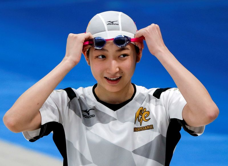 FILE PHOTO: Japanese swimmer Rikako Ikee takes part in the swimming demonstration during the opening ceremony of the Tokyo Aquatics Centre as the outbreak of the coronavirus disease (COVID-19) continues, in Tokyo