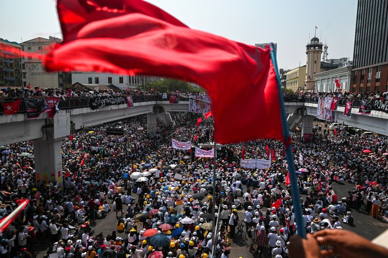 Demonstrators protest a against military coup in Yangon
