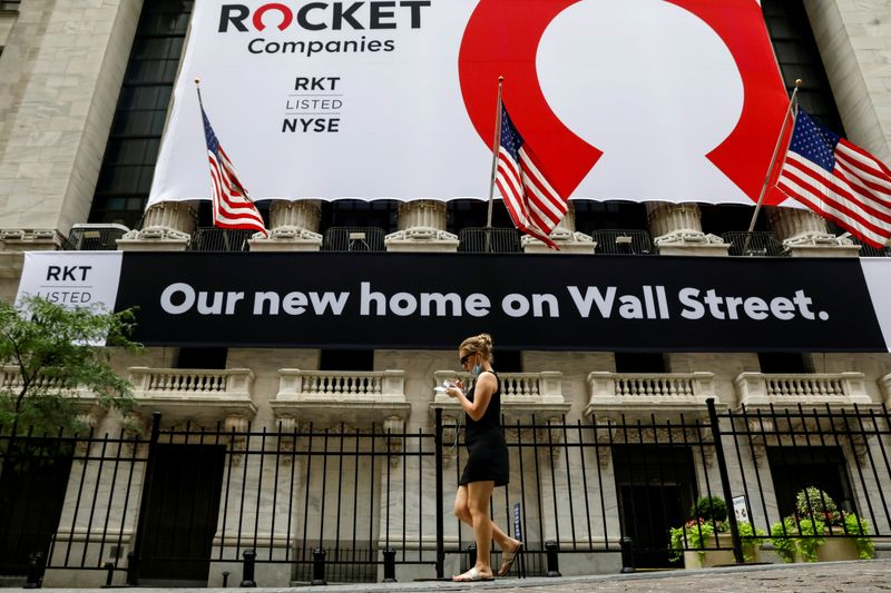FILE PHOTO: A banner celebrating Rocket Companies Inc. IPO is seen on the front facade of the NYSE in New York