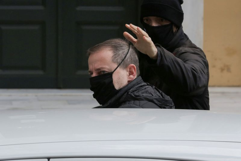 FILE PHOTO: Greek actor and former director of Greece's National Theatre Lignadis enters a car as he leaves prosecutor's office, in Athens