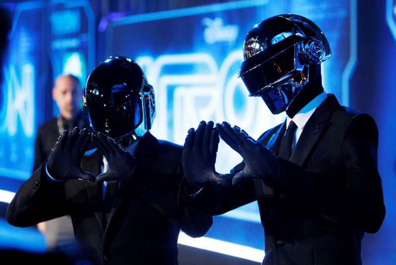 FILE PHOTO: Musicians Banglater and de Homem-Christo of Daft Punk pose at the world premiere of the film