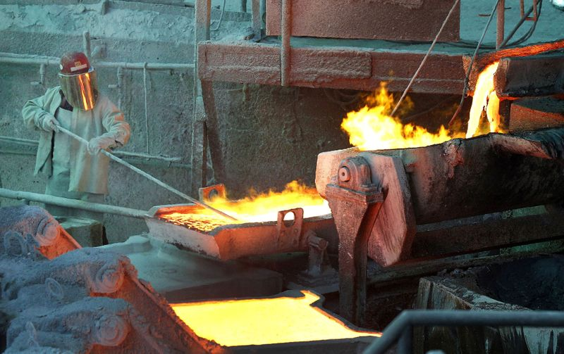 FILE PHOTO: A worker monitors a process at the Codelco Ventanas copper smelter in Ventanas, Chile