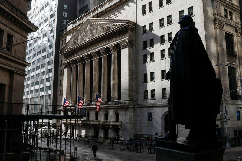 FILE PHOTO:  A statue of George Washington is seen on Wall St. across from the NYSE is seen in New York