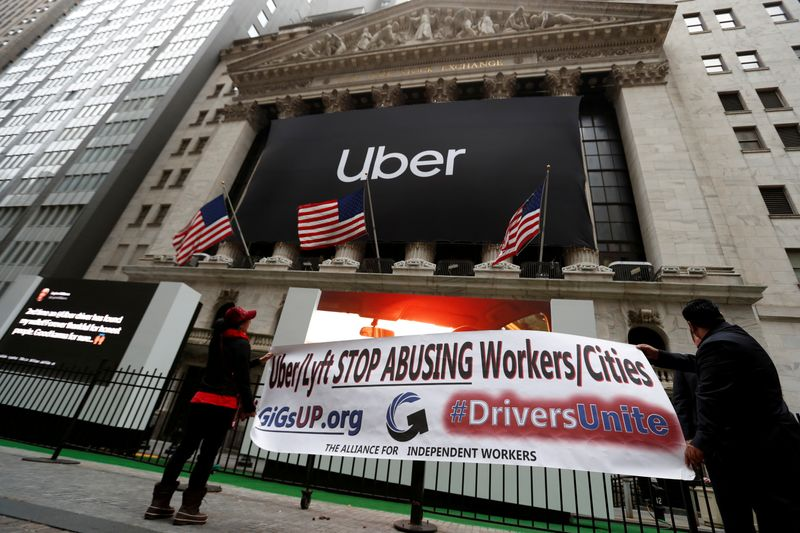 FILE PHOTO: Protestors display banner during Uber Technologies Inc'S IPO in New York