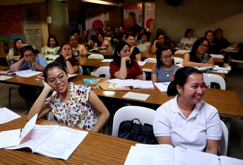 FILE PHOTO: Filipino workers, including nurses applying to work in United Kingdom, attend a lecture at a review center in Manila