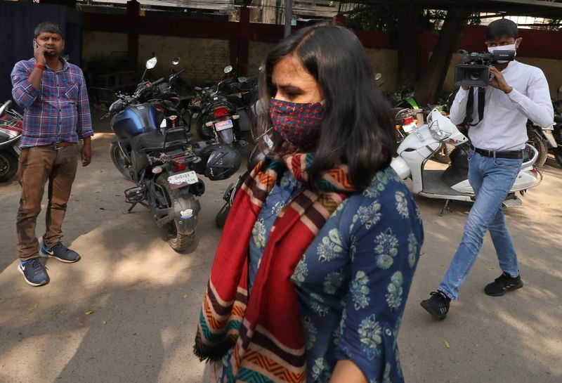 Aparna Purohit arrives for questioning at a police station in Lucknow