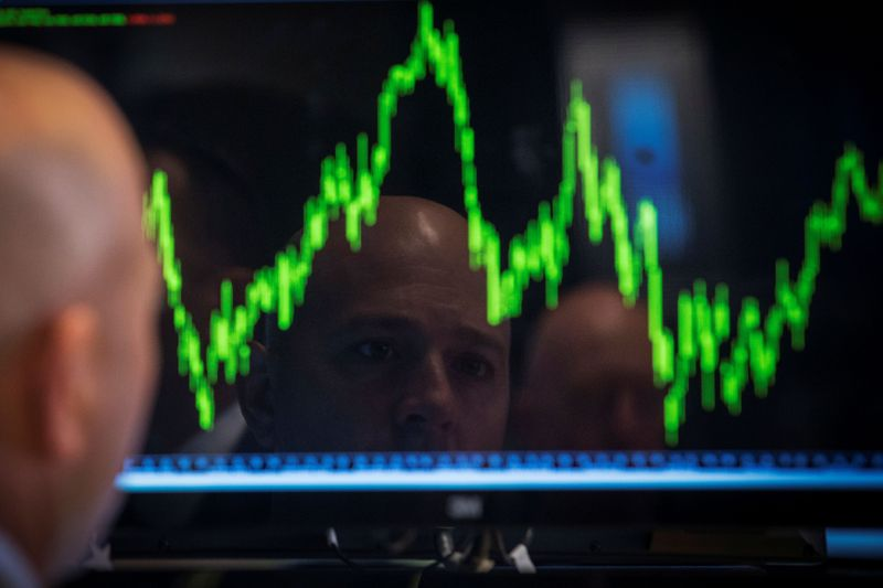 FILE PHOTO: A Specialist trader watches his chart while working on the floor of the New York Stock Exchange