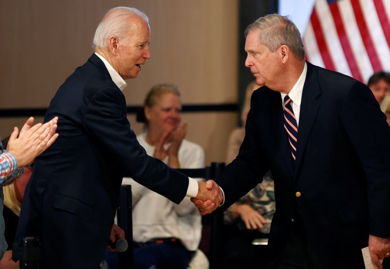 Democratic 2020 U.S. presidential candidate and former Vice President Joe Biden shakes hands with former Iowa Governor Tom Vilsack during a campaign event in Newton