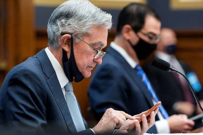 FILE PHOTO: Fed's Powell is pictured preparing to speak before a House committee in December