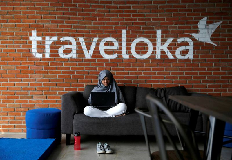 FILE PHOTO: An employee of Traveloka works at the company's headquarters in Jakarta