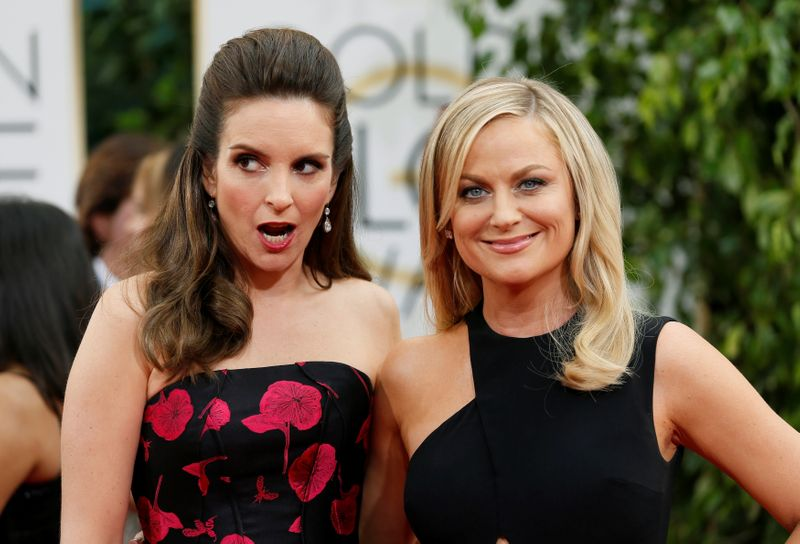 FILE PHOTO: Golden Globes hosts Tina Fey and Amy Poehler pose at the 71st annual Golden Globe Awards in Beverly Hills