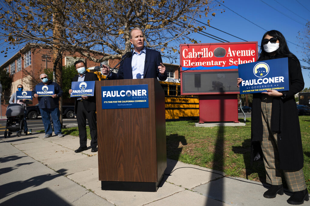 Former San Diego Mayor Kevin Faulconer, center, speaks during a news conference in Tuesday, Feb. 2, 2021, in the San Pedro section of Los Angeles. Faulconer announced Monday he is entering the race for California governor, the first major Republican to formally step into the contest while a potential recall election aimed at Democratic Gov. Gavin Newsom moves closer to qualifying for the ballot this year. (AP Photo/Jae C. Hong)