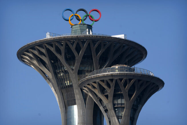 "The Olympic rings are visible atop the Olympic Tower in Beijing, Tuesday, Feb. 2, 2021. The 2022 Beijing Winter Olympics will open a year from now. Most of the venues have been completed as the Chinese capital becomes the first city to hold both the Winter and Summer Olympics. Beijing held the 2008 Summer Olympics. But these Olympics are presenting some major problems. They are already scarred by accusations of rights abuses including ""genocide""against more than 1 million Uighurs and other Muslim ethnic groups in western China. (AP Photo/Mark Schiefelbein)"