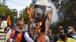 burn portraits of Meena Harris, niece of U.S. Vice President Kamala Harris, and Greta Thunberg in New Delhi, India, Thursday, Feb. 4, 2021. As the farmers camp out at the edges of the capital, protesting new agricultural laws they say will devastate their earnings, the mainstream and social media have come under unprecedented attacks from Prime Minister Narendra Modi's Bharatiya Janata Party. Critics say it has used the massive demonstrations to escalate a crackdown on free speech, detaining journalists and freezing Twitter accounts. (AP Photo/Dinesh Joshi)