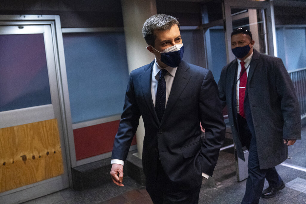 Transportation Secretary Pete Buttigieg walks through Union Station after speaking in Washington, Friday, Feb. 5, 2021. (AP Photo/Carolyn Kaster)