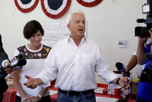 FILE - In this Nov. 6, 2018 file photo California Republican gubernatorial candidate John Cox speaks during campaign stop as Rep. Mimi Walters, R-Calif., looks on in Irvine, Calif. Cox formally opened his campaign for California governor Monday, Feb. 8, 2021, with a TV ad depicting his leading GOP rival as a political twin of Democratic Gov. Gavin Newsom and promising to work for lower housing costs and new jobs. (AP Photo/Chris Carlson, File)