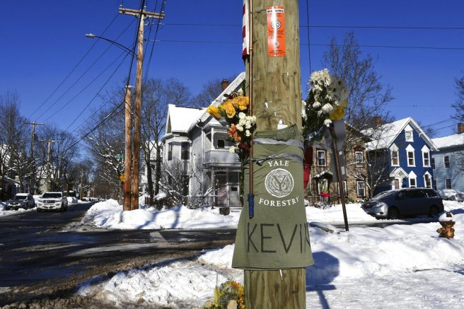 A memorial for Yale School of the Environment student Kevin Jiang near the scene of his shooting at the corner of Nicoll and Lawrence Street in New Haven, Conn., Monday, Feb. 8, 2021. (Arnold Gold/Hearst Connecticut Media via AP)