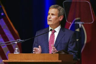 Tennessee Gov. Bill Lee delivers his State of the State Address in War Memorial Auditorium, Monday, Feb. 8, 2021, in Nashville, Tenn. (AP Photo/Mark Humphrey)