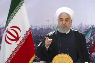 In this photo released by the official website of the office of the Iranian Presidency, President Hassan Rouhani addresses the nation in a televised speech in Tehran, Iran, Wednesday, Feb. 10, 2021. Rouhani said the West has no way except reaching an agreement with Tehran for restoring 2015 nuclear deal as the nation marked the anniversary of the country's 1979 Islamic Revolution on Wednesday on wheels - cars, motorcycles, bicycles - instead of traditional rallies and marches because of the region's worst outbreak of the coronavirus. (Iranian Presidency Office via AP)