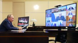 Russian President Vladimir Putin attends a meeting with the Government via video conference at the Novo-Ogaryovo residence outside Moscow, Russia, Wednesday, Feb. 10, 2021. (Mikhail Klimentyev, Sputnik, Kremlin Pool Photo via AP)