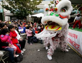 FILE - In this Jan. 21, 2006, file photo, Chinese lion dancers perform in Oakland's Chinatown in Oakland, Calif. Police are stepping up patrol and volunteers are increasing their street presence after several violent attacks on older Asians stoked fear in the San Francisco Bay Area's Chinatowns and subdued the celebratory mood leading up to Chinese New Year. (AP Photo/Paul Sakuma, File)