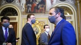 Sen. Ted Cruz, R-Texas, walks off the Senate floor at the conclusion of the third day of the second impeachment trial of Trump in the Senate, at the Capitol, Thursday, Feb. 11, 2021, in Washington. (Mandel Ngan/Pool via AP)