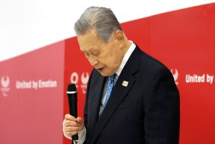 Olympics organizing committee president Yoshiro Mori announces his resignation at a meeting with council and executive board members at the committee headquarters in Tokyo on Friday, Feb. 12, 2021. Tokyo Olympics organizing committee president Yoshiro Mori resigned for his sexist remarks. (Yoshikazu Tsuno/Pool Photo via AP)