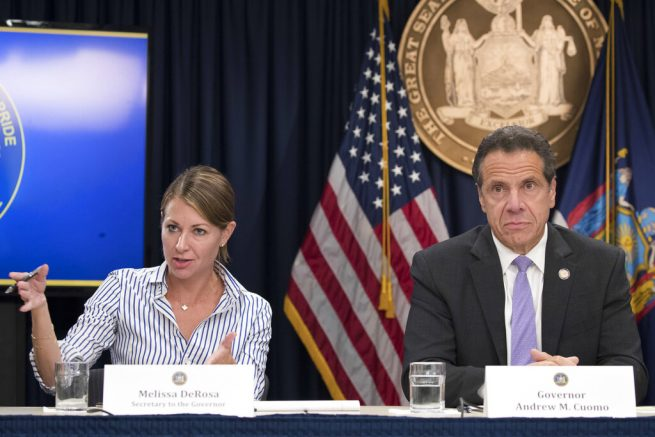 "FILE — In this Sept. 14, 2018 file photo, Secretary to the Governor Melissa DeRosa, is joined by New York Gov. Andrew Cuomo as she speaks to reporters during a news conference, in New York. De Rosa, Cuomo's top aide, told top Democrats frustrated with the administration's long-delayed release of data about nursing home deaths that the administration ""froze"" over worries about what information was ""going to be used against us,"" according to a Democratic lawmaker who attended the Wednesday, Feb. 10, 2021 meeting and a partial transcript provided by the governor's office. (AP Photo/Mary Altaffer, File)"