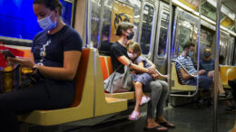 FILE - This photo from Monday, Aug. 17, 2020, shows riders on a subway train wearing protective masks due to COVID-19 concerns in New York. The Metropolitan Transportation Authority on Friday launched a campaign that has celebrities including Jerry Seinfeld, Whoopi Goldberg, and Awkwafina making the announcements heard at subway stations, on trains, and buses. (AP Photo/John Minchillo, File)