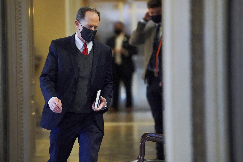 Sen. Pat Toomey, R-Pa., arrives at the start of the fifth day of the second impeachment trial of former President Trump, Saturday, Feb. 13, 2021 at the Capitol in Washington. (Greg Nash/Pool via AP)