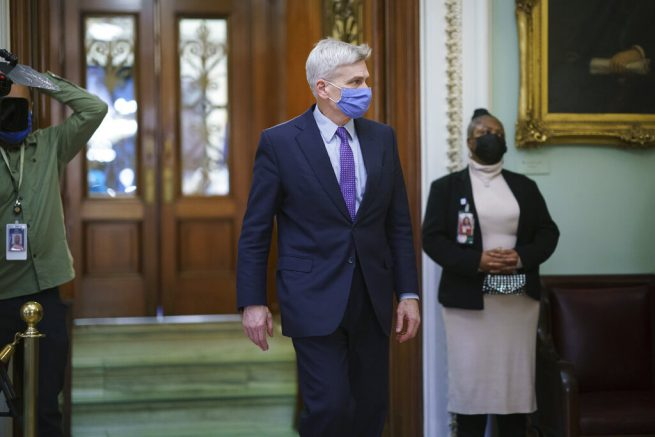 Sen. Bill Cassidy, R-La., leaves the chamber as the Senate voted to consider hearing from witnesses in the impeachment trial of former President Donald Trump, at the Capitol in Washington, Saturday, Feb. 13, 2021. (AP Photo/J. Scott Applewhite)