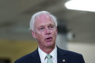 "Sen. Ron Johnson, R-Wis., talks to reporters on Capitol Hill in Washington, Friday, Feb. 12, 2021. Johnson downplayed the storming of the U.S. Capitol last month, saying on conservative talk radio Monday, Feb. 15, 2021 that it ""didn't seem like an armed insurrection to me."" (AP Photo/Susan Walsh, file)"