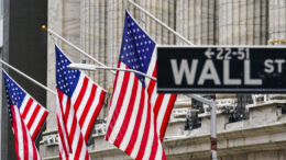 American flags hang outside of the New York Stock Exchange Tuesday, Feb. 16, 2021, in New York. Stocks were modestly higher in early trading Tuesday, pushed by energy companies who have seen record electricity prices due to the frigid cold weather impacting much of the country. (AP Photo/Frank Franklin II)