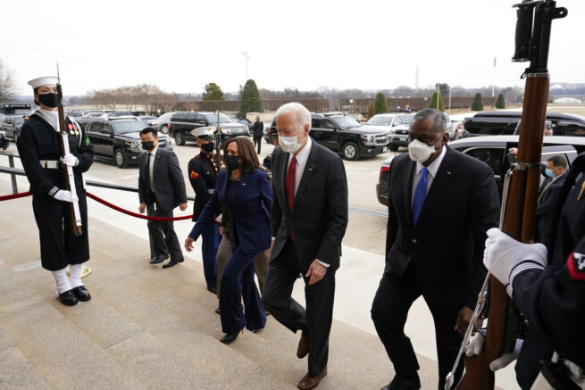 In this Feb. 10, 20201, photo, President Joe Biden and Vice President Kamala Harris walk with Joint Chiefs Chairman Gen. Mark Milley and Secretary of Defense Lloyd Austin at the Pentagon in Washington. The Biden administration faces a conundrum as it rethinks the positioning of military forces around the world: How to focus more on China and Russia without retreating from longstanding Mideast threats — and to make this shift with potentially leaner Pentagon budgets. (AP Photo/Alex Brandon, Pool)