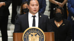 """FILE - In this June 8, 2020, file photo, Assemblyman Ron Kim, D-Queens, speaks during a press briefing at the state Capitol in Albany, N.Y. Kim says Gov. Andrew Cuomo vowed to """"destroy"""" him, during a private phone call last week for criticizing his handling of COVID-19 outbreaks at nursing homes. (AP Photo/Hans Pennink, File)"""