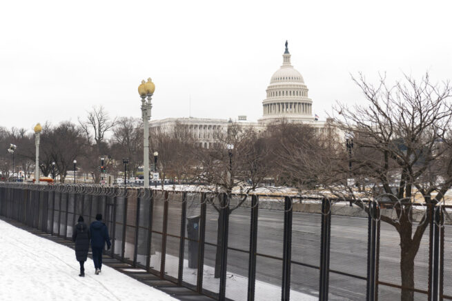The U.S. Capitol is seen behind the metal security fencing Thursday, Feb. 18, 2021, in Washington. U.S. Capitol Police officials told congressional leaders the razor-wire topped fencing around the Capitol should remain in place for several more months as law enforcement continues to track threats against lawmakers, a person familiar with the matter told The Associated Press. (AP Photo/Manuel Balce Ceneta)
