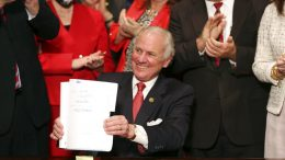"""South Carolina Gov. Henry McMaster holds up a bill banning almost all abortions in the state after he signed it into law on Thursday, Feb. 18, 2021, in Columbia, S.C. On the same day, Planned Parenthood filed a federal lawsuit to stop the measure from going into effect. The state House approved the """"South Carolina Fetal Heartbeat and Protection from Abortion Act"""" on a 79-35 vote Wednesday and gave it a final procedural vote Thursday before sending it to McMaster. (AP Photo/Jeffrey Collins)"""