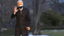 Joe Biden walks on the South Lawn of the White House after stepping off Marine One, Friday, Feb. 19, 2021, in Washington. Biden is returning to Washington after visiting Pfizer's COVID-19 vaccine manufacturing site near Kalamazoo, Mich. (AP Photo/Patrick Semansky)