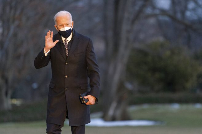 Joe Biden walks on the South Lawn of the White House after stepping off Marine One Friday Feb. 19 2021 in Washington. Biden is returning to Washington after visiting Pfizer's COVID-19 vaccine manufacturing site near Kalamazoo Mich. (AP