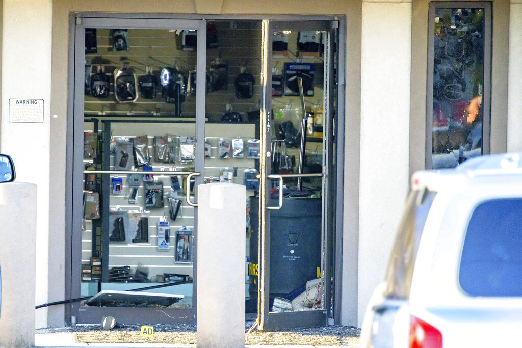 The scene of a multiple fatality shooting at the Jefferson Gun Outlet in Metairie, La., Saturday, Feb. 20, 2021. A suspect fatally shot several people at a gun store in a suburb of New Orleans on Saturday afternoon, and the shooter also died during gunfire as others engaged the suspect both inside and outside the outlet, authorities said. (AP Photo/Matthew Hinton)
