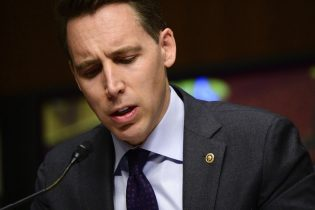 Sen. Josh Hawley, R-Mo.,speaks during a Senate Homeland Security and Governmental Affairs & Senate Rules and Administration joint hearing on Capitol Hill, Washington, Tuesday, Feb. 23, 2021, to examine the January 6th attack on the Capitol. (Erin Scott/The New York Times via AP, Pool)