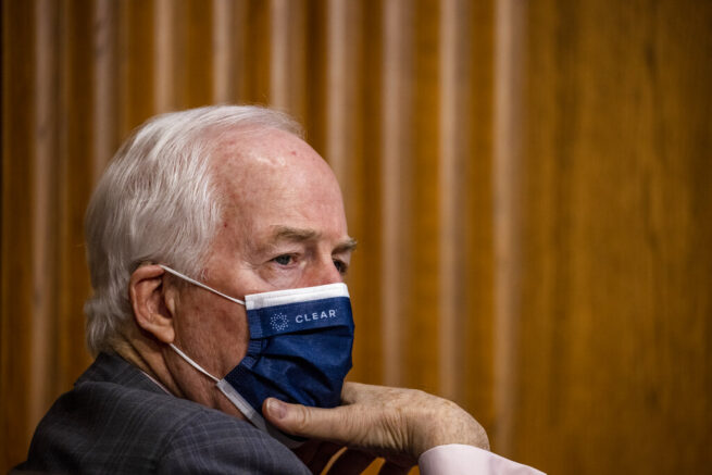 Sen. John Cornyn, R-Texas, listens during a Senate Finance Committee hearing on the nomination of Katherine Tai to be U.S. trade representative on Capitol Hill, in Washington, Thursday, Feb. 25, 2021. (Tasos Katopodis/Pool via AP)