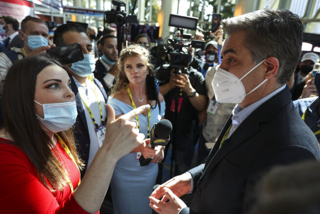 A woman argues with CNN reporter Jim Acosta outside the Conservative Political Action Conference (CPAC) on Friday, Feb. 26, 2021, in Orlando, Fla. (Sam Thomas/Orlando Sentinel via AP)